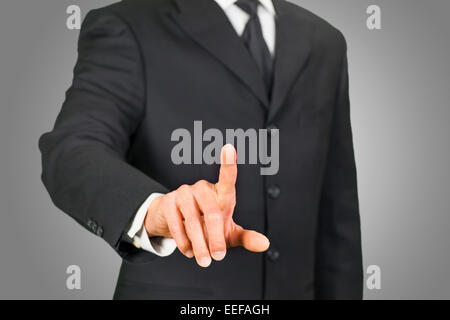 Businessman clicking on touch screen - Stock Photo