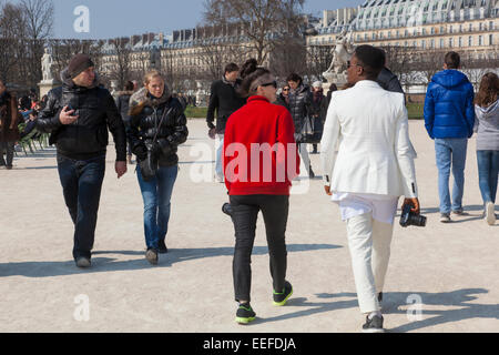 people walking along the Tuileries in Paris, France - Stock Photo