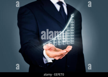 Businessman with a rising chart in wireframe mode - Stock Photo