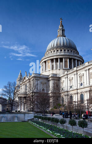 London, England, January 2015, A portrait view of pedestrians walking ourside St Paul's Cathedral during winter. - Stock Photo