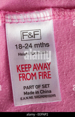 label in clothing - F&F 18-24 mths height 92cm 36in keep away from fire part of set made in China - sold in the - Stock Photo