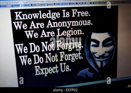 Message screen computer on a website hacked into by worldwide hacktivist group Anonymous hackers - Stock Photo