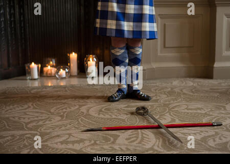 lower view of the start of the traditional Scottish highland sword dancing - Stock Photo