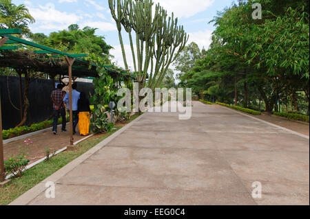 Visitors walking along  the mass graves of the victims of the 1994 Rwandan genocide. Kigali Genocide Memorial Centre. - Stock Photo