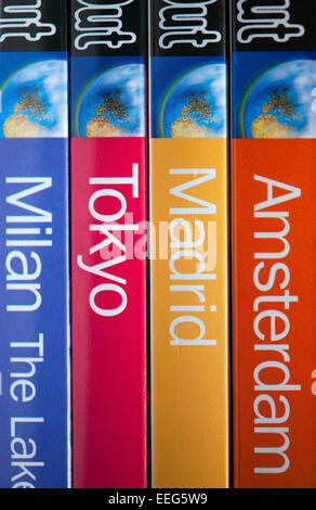 A row of colourful Time Out Travel Guide Books - Stock Photo