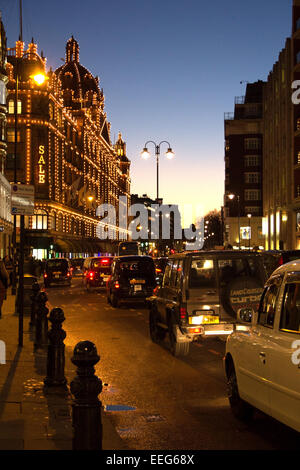Harrods department store lit up at night. - Stock Photo