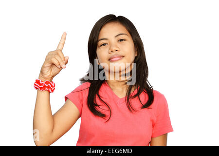 Pretty Asian teen pointing up for having a good idea - Stock Photo