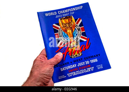 Hand holding a World Cup Final 1966 England v West Germany program (programme) - Stock Photo