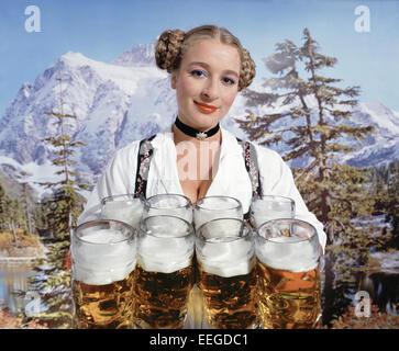 Hamburg, Germany, woman in dirndl with Bierkruegen - Stock Photo