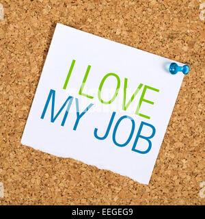 I Love My Job Reminder Note Pinned to a Cork Memory Bulletin Board on Office Wall - Stock Photo