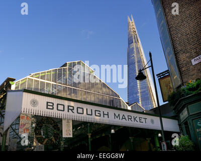 Borough Market a renowned popular international produce retail market with The Shard behind London Bridge Southwark - Stock Photo