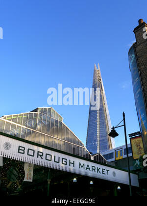 Borough Market a renowned popular international produce retail market with 'The Shard' behind London Bridge Southwark - Stock Photo