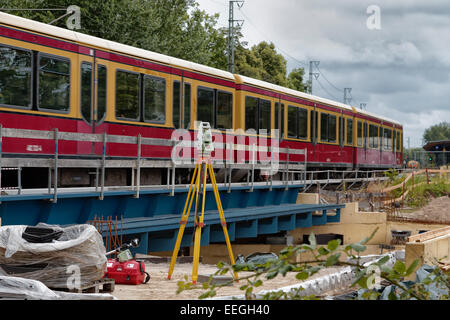 Berlin, Germany, S-Bahn train passes a construction site - Stock Photo