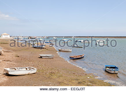 Boats on shore in Santa Luzia - Stock Photo