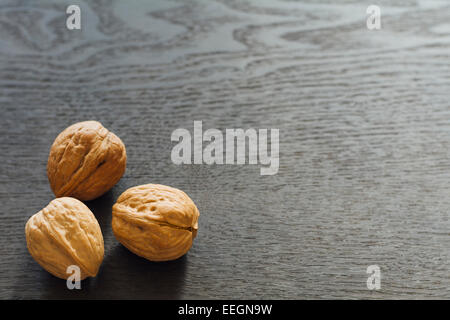 Whole walnuts in the shell - Stock Photo