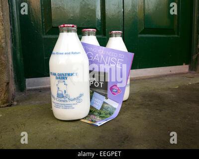 Glass Bottles Of Milk On A Doorstep Delivered By Milkman