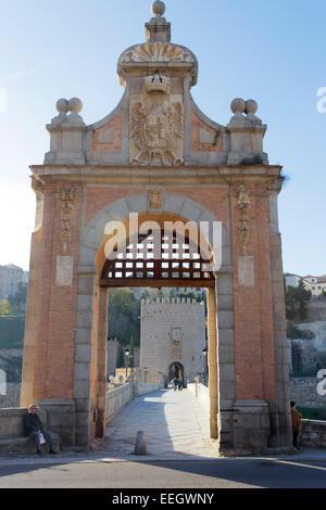 Toledo, Toledo Province, Castilla-La Mancha, Spain. The Alcantara bridge over the Tagus river. - Stock Photo