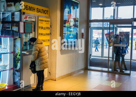 Kiev, Ukraine. 18th Jan, 2015. Women change the currency in the exchange office. -- The Ukrainian government will - Stock Photo