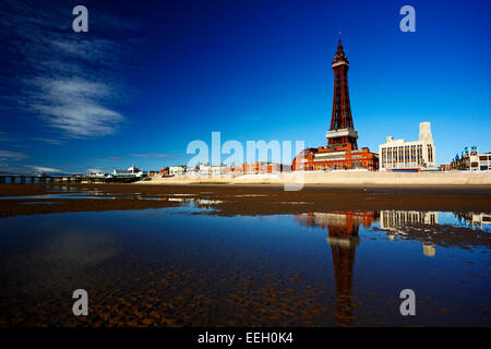reflection of Blackpool tower and seafront promenade in pool on the beach lancashire england uk - Stock Photo
