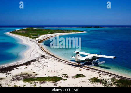 dehaviland dhc-3 otter seaplane on the beach and bush key at the dry tortugas florida keys usa - Stock Photo