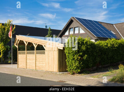 Solar Carport 'Sunport' providing shelter and charging energy for two electric cars or plug-in hybrid like BMW i8, - Stock Photo