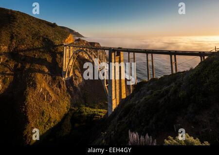 Bixby Bridge Pacific Coast Highway Big Sur California. Bixby Creek Canyon Bridge with coastal fog mist rolling in - Stock Photo