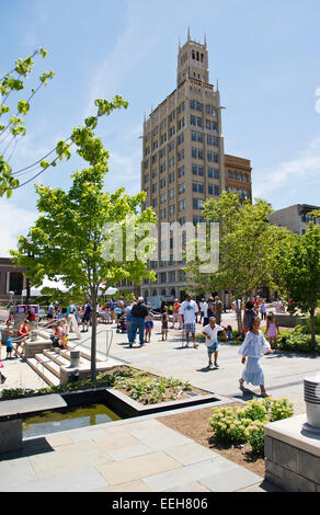 Many people in Pack Square Park in downtown Asheville NC on a bright summer day - Stock Photo