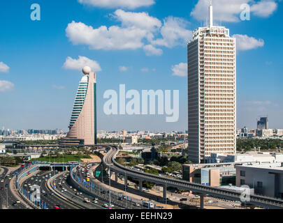 View along Sheikh Zayed Road and the Ghweifat International Highway, Dubai, with iconic Etisalat Tower 2 and Dubai - Stock Photo