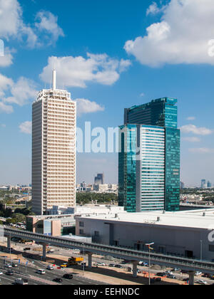 Modern buildings cityscape:View of the Dubai World Trade Centre, Dubai, UAE across the Ghweifat International Highway - Stock Photo