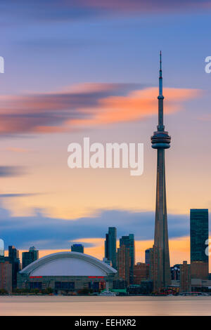 Toronto CN Tower at sunset with a long exposure, taken from the Toronto Islands. - Stock Photo