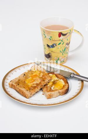 Tea and toast on a white background. - Stock Photo