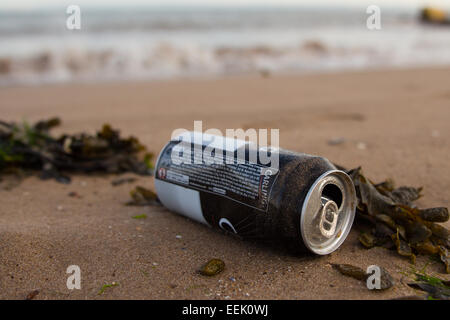A discarded tin can on a beach at Porthcawl, South Wales. - Stock Photo