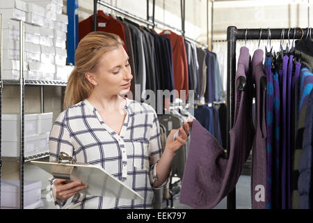 Businesswoman Running On Line Fashion Business - Stock Photo