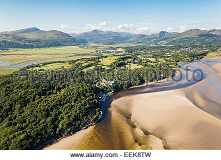 Aerial view of Dwyryd estuary and Portmeirion Village with Snowdonia in the background - Stock Photo