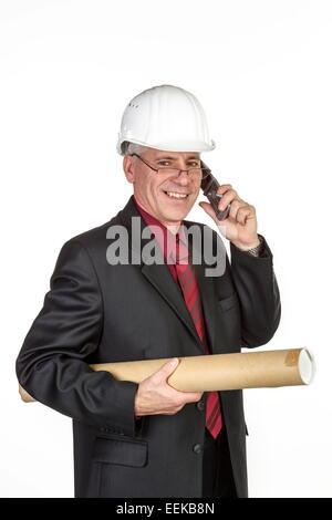Architekt mit Bauhelm, telefoniert,  Architekt with safety-helmet telephones - Stock Photo