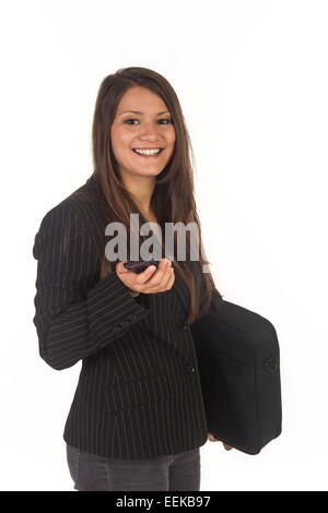 Junge dunkelhaarige Frau mit Aktentasche und Handy, Young dark-haired woman with a briefcase and cell phone - Stock Photo