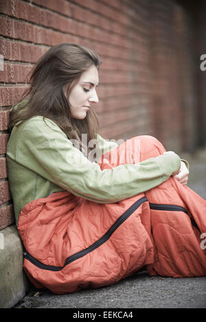 Vulnerable Teenage Girl Sleeping On The Street - Stock Photo