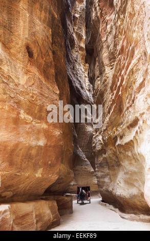 View along the Siq on the way to Petra, Jordan - Stock Photo