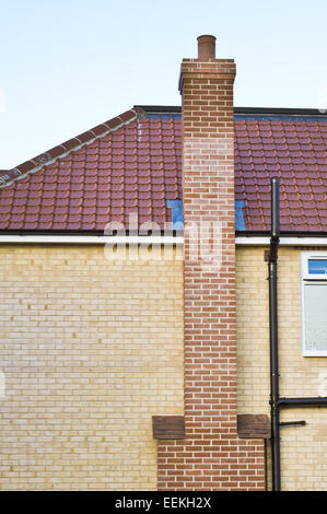 Modern house with a red brick chimney stack - Stock Photo
