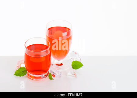 Two glasses of red fruit flavored drinks - Stock Photo