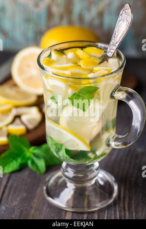 Glass with mint and lemon tea - Stock Photo