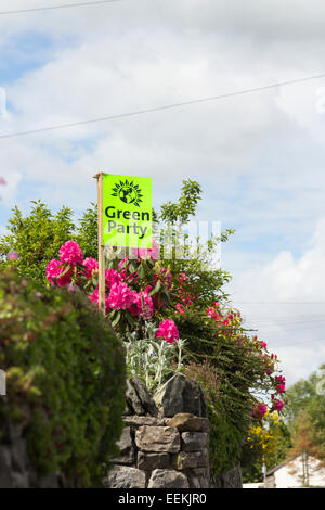 Green Party election campaign support banner in the garden of a house on Windermere Road, Kendal. - Stock Photo