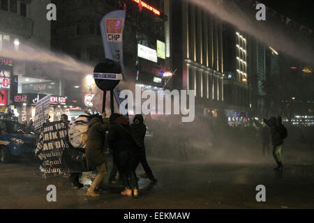 Ankara, Turkey. 19th Jan, 2015. Turkish police used water cannons and tear gas to disperse demonstrators of walking - Stock Photo
