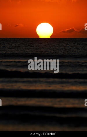 sun rising over the irish sea first thing in the morning - Stock Photo