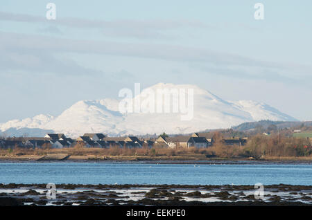 Residential district in Dumbarton on the River Clyde Estuary with the snow covered Ben Lomond behind. - Stock Photo