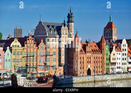 Gdansk Poland. Old Town centre. Dlugie Pobrzeze and Mariacka Gate frontage on the Motlawa River tourist area. Summer - Stock Photo