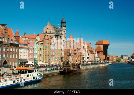 Gdansk Poland. Old Town. Looking down Dlugie Pobrzeze to Mariacka Gate and the Crane Gate on the Motlawa River tourist - Stock Photo