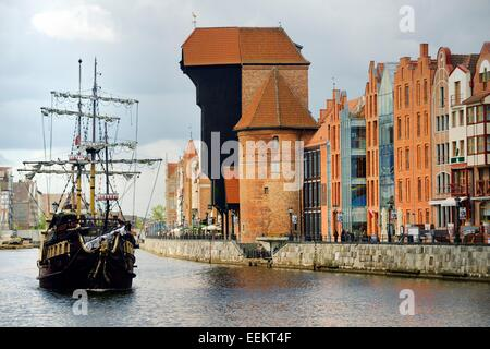 Gdansk Poland. Old Town. Medieval Crane Gate rises over the Motlawa River and historic buildings on the Dlugie Pobrzeze - Stock Photo