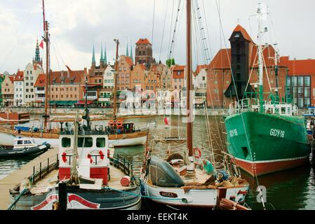 Gdansk Poland. Old Town. Fishing boats on the Motlawa River. Medieval Crane Gate and historic buildings on the Dlugie - Stock Photo