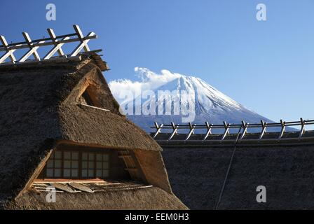 thatched farmhouses with Mt. Fuji - Stock Photo
